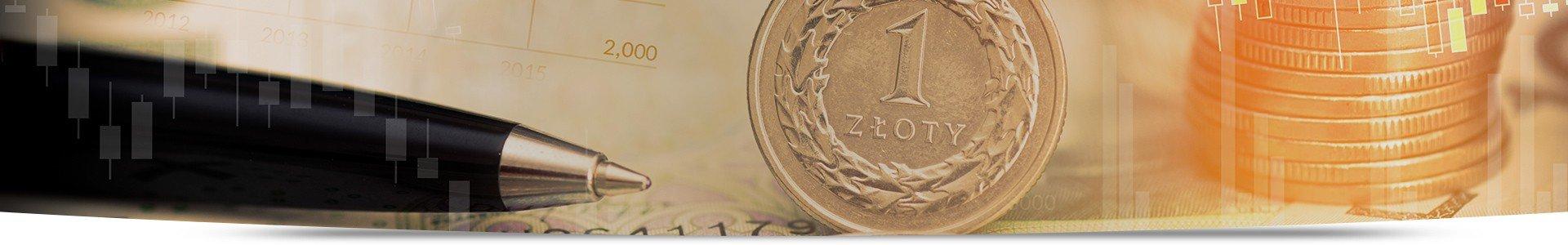 Długopis, złotówka oraz stos monet